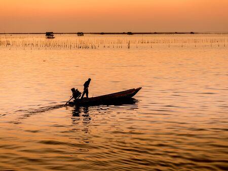 back home: Fishing boat coming back home , sunset light