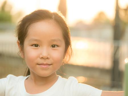 adorable Asian cute girl  close up head shot , healthy girl, sunset light Stock Photo