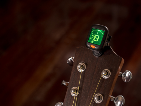tuner for Guitar , B sound, second string , clip on guitar head Stock Photo