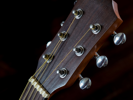 detail of Tuning head for acoustic guitar, peg , close up shot, black background Stock Photo