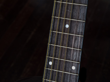 Detail shots of an acoustic  guitar, fretboard Stock Photo