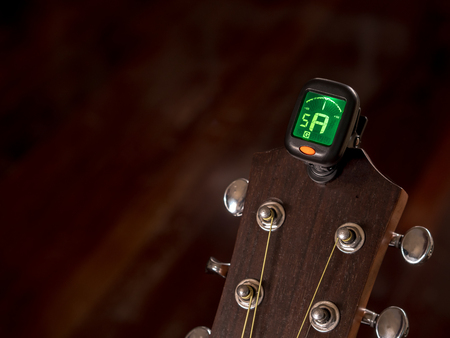 tuner for Guitar , A sound, Fifth String ,clip on guitar head Stock Photo