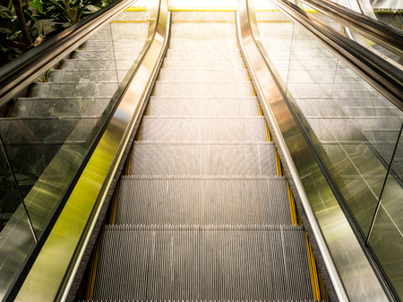 Top view of escalators , sun light from outside