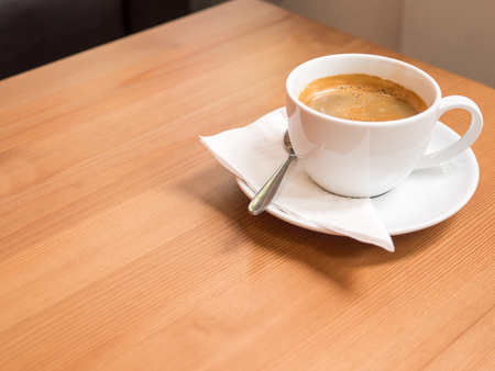 americano coffee  with freshly brewed coffee, on wood table, with white napkin