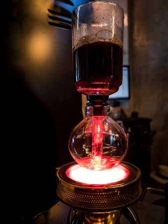Siphon vacuum coffee maker, preparation Stock Photo
