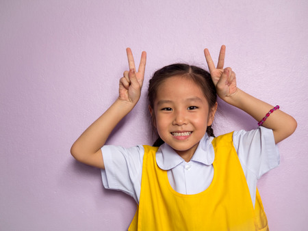 Portrait of Asian happy little girl , smile, school uniform Stock Photo
