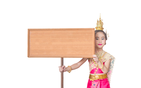 Asian little kid girl dress the Thai traditional dress , National Costumes, hold a signboard , white background Stock Photo