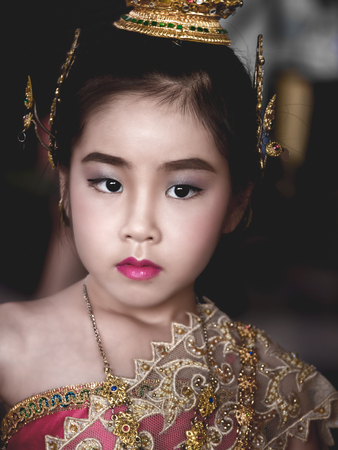Asian little kid girl dress the Thai traditional dress , National Costumes, close up shot Stock Photo