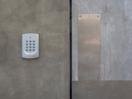 security keypad for access control, on concrete wall Stock Photo