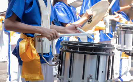 Closeup of group of boy and girl in Thai traditional uniform with drums. , snare drum Stockfoto