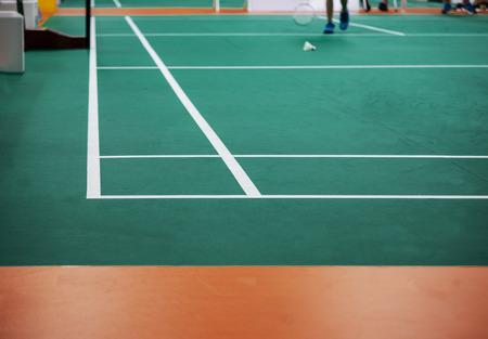 Indoor badminton court,shuttle cock on the floor,  selective focus