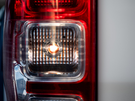 Closeup of a taillight on a truck, turn signal open