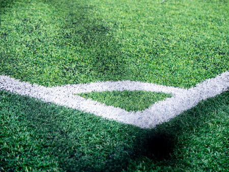 Soccer field, corner side, made from synthetic lawn,selective focus, behind the net
