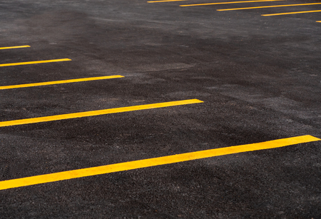 Parking lot for motorcycle and bicycle with yellow line background. asphalt road