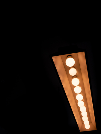 close up of ceiling lamp with a row of led warm light is on