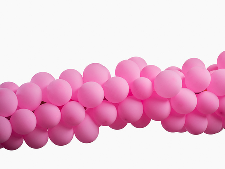 Pink color decorated balloons in a row over white background , with clipping path