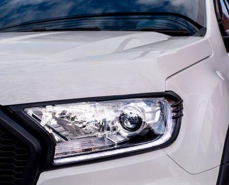 Closeup of a headlight on a modern car