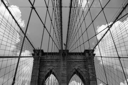 The Brooklyn Bridge is a bridge in New York City and is one of the oldest suspension bridges in the United States. Completed in 1883, it connects the boroughs of Manhattan and Brooklyn by spanning the East River. With a main span of 1,595.5 feet (486.3 m) photo