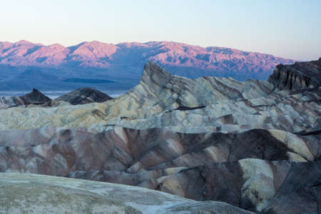 Zabriskie Point is a part of Amargosa Range located in east of Death Valley in Death Valley National Park in the United States Noted for its erosional landscape. It is composed of sediments from Furnace Creek Lake, Which dried up 5 million years ago long photo