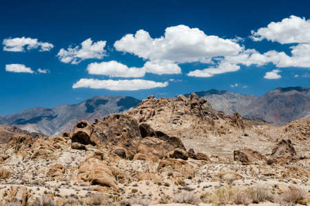owens valley: Alabama Hills are a range of hills  and rock formations near the eastern slope of the Sierra Nevada Mountains in the Owens Valley, west of Lone Pine in Inyo County, California.Though geographically-considered a range of hills,