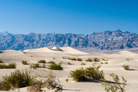 sand quarry: Rising up nearly a 100 feet above Mesquite Flat, Death Valley Stock Photo