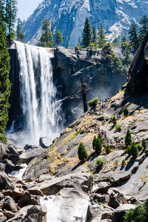 vernal: Vernal Fall is a 317 feet waterfall on the Merced River just downstream of Nevada Fall in Yosemite National Park, California. Vernal Fall, as well as Nevada case is CLEARLY visible from Glacier Point.