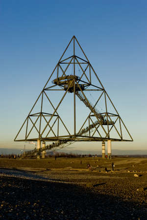 slag: Bottrop, Germany - January 13, 2008: Bottrop Tetraeder is a 60 m high Tetrahedron, placed on a 90 m slag heap in Bottrop a city in west central Germany, on the Rhine-Herne Canal, in North Rhine-Westphalia. Editorial