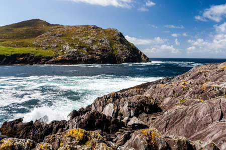 Dursey Island, Beara Peninsula, County Cork, Ireland - August 18, 2010: Dursey Island is separated from the mainland by a narrow stretch of water called Dursey Sound which has a very strong tidal race, with a reef of rocks in the centre of the channel whi Stock Photo