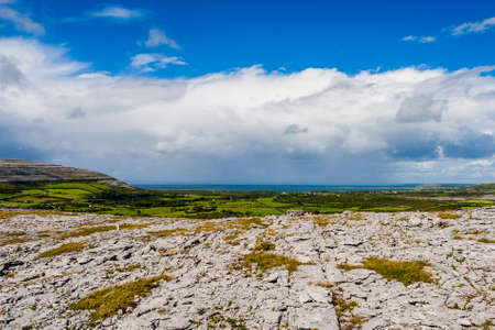burren:  The Burren measures 250 square kilometres and is enclosed roughly within the circle made by the villages of Ballyvaughan, Kilfenora and Lisdoonvarna. Stock Photo
