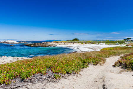 The 17 Mile Drive is a scenic road through Pacific Grove and Pebble Beach in Big Sur, Monterey, California, USA. Stock Photo