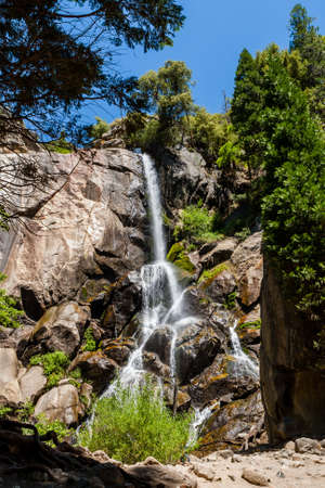 typical: Grizzly Falls is probably the most attractive waterfall on a typical tour into the Cedar Grove section of Sequoia National Forest near Kings Canyon National Park. Stock Photo