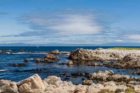 17: The 17 Mile Drive is a scenic road through Pacific Grove and Pebble Beach in Big Sur, Monterey, California, USA. Stock Photo