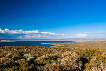 mono: Mono Lake is a large, shallow saline soda lake in Mono County, California, formed at least 760,000 years ago as a terminal lake in an endorheic basin. Stock Photo