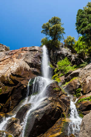kings canyon national park: Grizzly Falls is probably the most attractive waterfall on a typical tour into the Cedar Grove section of Sequoia National Forest near Kings Canyon National Park. Stock Photo