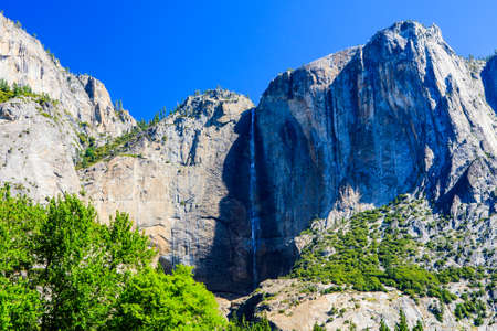 high sierra: Yosemite Valley is a glacial valley in Yosemite NP in the western Sierra Nevada mountains of California. The valley is about 13 km long and up to a mile deep, surrounded by high granite summits.