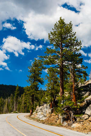 Tioga Pass is a mountain pass in the Sierra Nevada mountains. State Route 120 runs through it, and serves as the eastern entry point for Yosemite National Park, at the Tioga Pass Entrance Station. Stock Photo