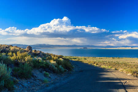 Mono Lake is a large, shallow saline soda lake in Mono County, California, formed at least 760,000 years ago as a terminal lake in an endorheic basin. Stok Fotoğraf
