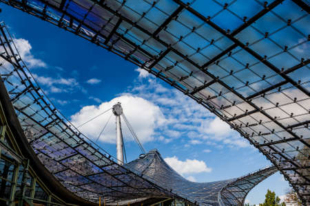 building structure: MUNICH, GERMANY - SEPTEMBER 14, 2012: Detail of the roof of the Olympiastadion, constructed in 1972. The lightweight tent construction of the Olympiastadion was considered revolutionary for its time.