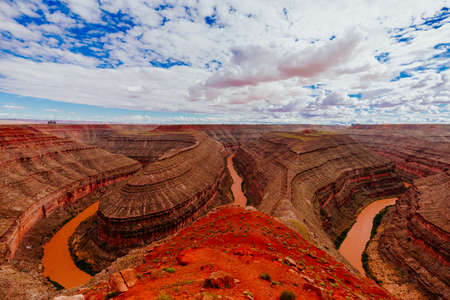 Gaze at the results of 300 million years of time, where the San Juan River winds and carves its way through the desert 1,000 feet below.