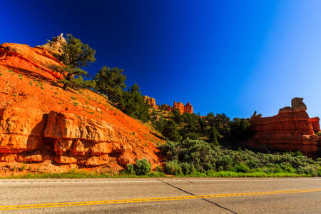 exceptionally: Unique vermilion-colored rock formation and stands of Ponderosa pines make the canyon exceptionally scenic.