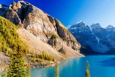 Moraine Lake is a glacially-fed lake in Banff National Park 14 km outside of Lake Louise, Alberta, Canada. It is situated in the Valley of the Ten Peaks, at an elevation of approximately 1885 m. Stock Photo
