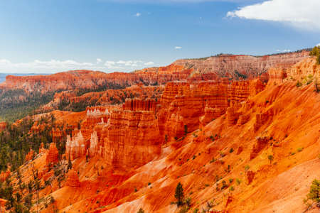 Bryce Canyon is a collection of natural amphitheaters aside of the Paunsaugunt Plateau. Bryce is distinctive due to geological structures called hoodoos, formed by frost weathering and stream erosion. Stock Photo