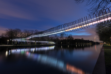Oberhausen, NRW, Germany - February 21, 2017 At 6.48pm : Illuminated Bridge Slinky Springs To Fame Editorial