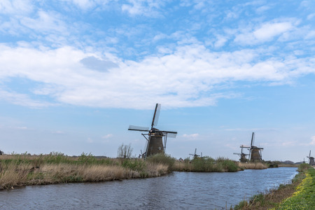 holland: Windmills At A Small River In Netherlands