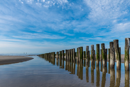 Groyne Pillars At Beautiful Lonely Beach Of Domburg With Waterreflections - Zeeland