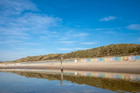 Beautiful Lonely Beach Of Domburg With Waterreflections And Groyne Pillars - Zeeland Stock Photo