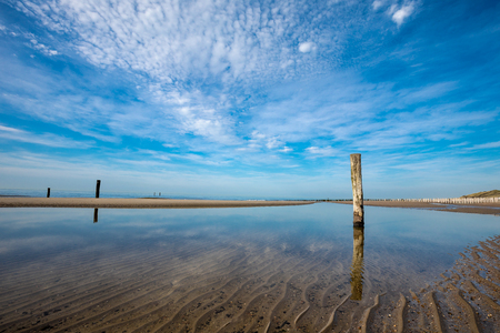 Beautiful Lonely Beach Of Domburg With Waterreflections And Groyne Pillars - Zeeland