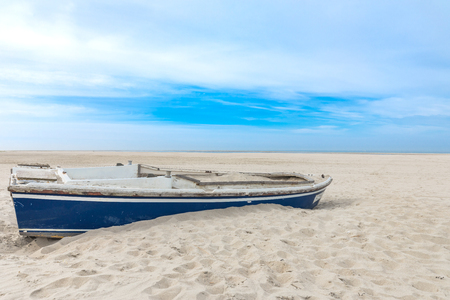 Shipwrecked Boat At The Beach WIth Blue Sky Stock Photo
