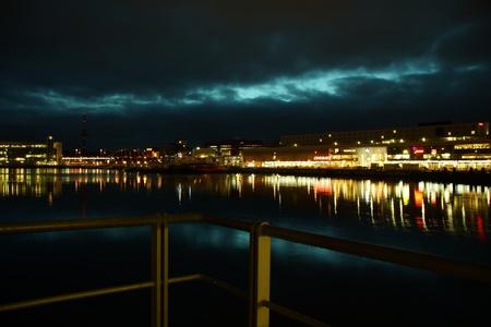 Kiel illuminated skyline at night with harbour and glowing sky Stock Photo - 17402612