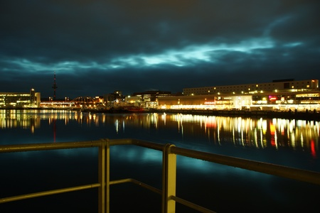 Kiel illuminated skyline at night with harbour and glowing sky Stock Photo - 17402668